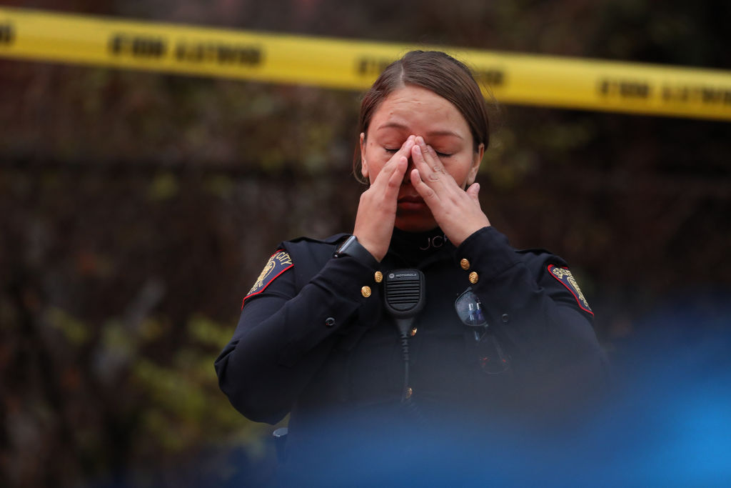 A Jersey City police officer reacts at the scene of a shooting that left multiple people dead on Dec. 10, 2019 in Jersey City, New Jersey.