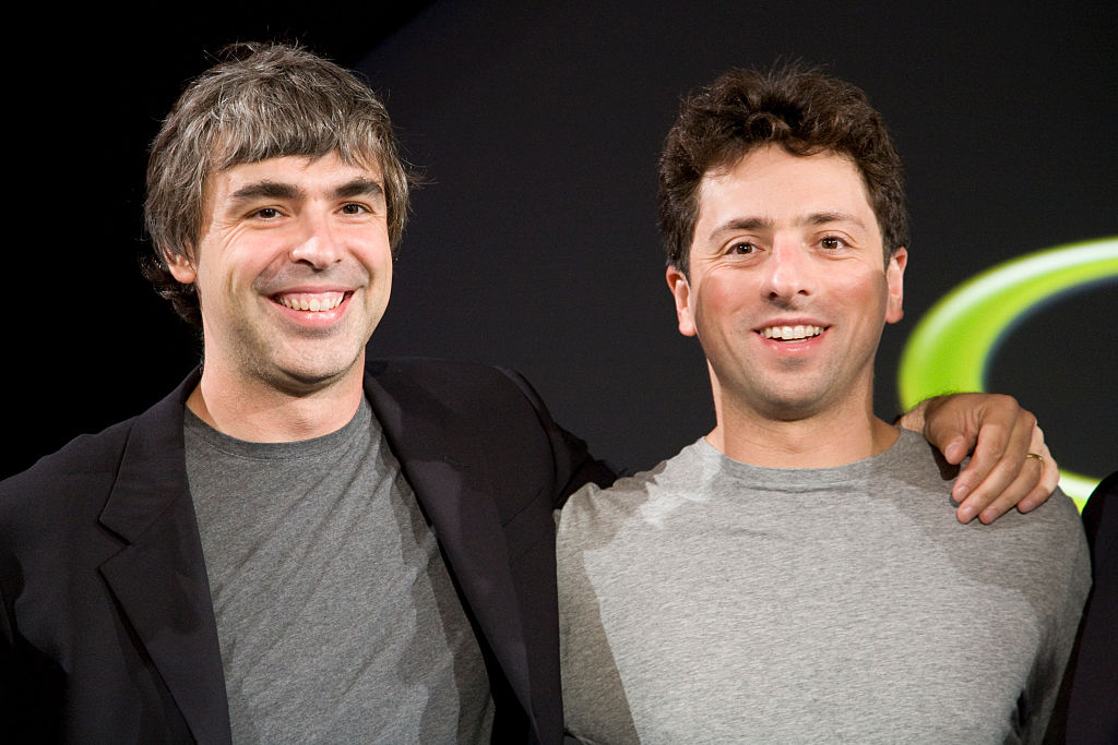 Larry Page (L) and Sergey Brin (R), the co-founders of Google, at a press event where Google and T-Mobile announced the first Android powered cellphone, the T-Mobile G1.