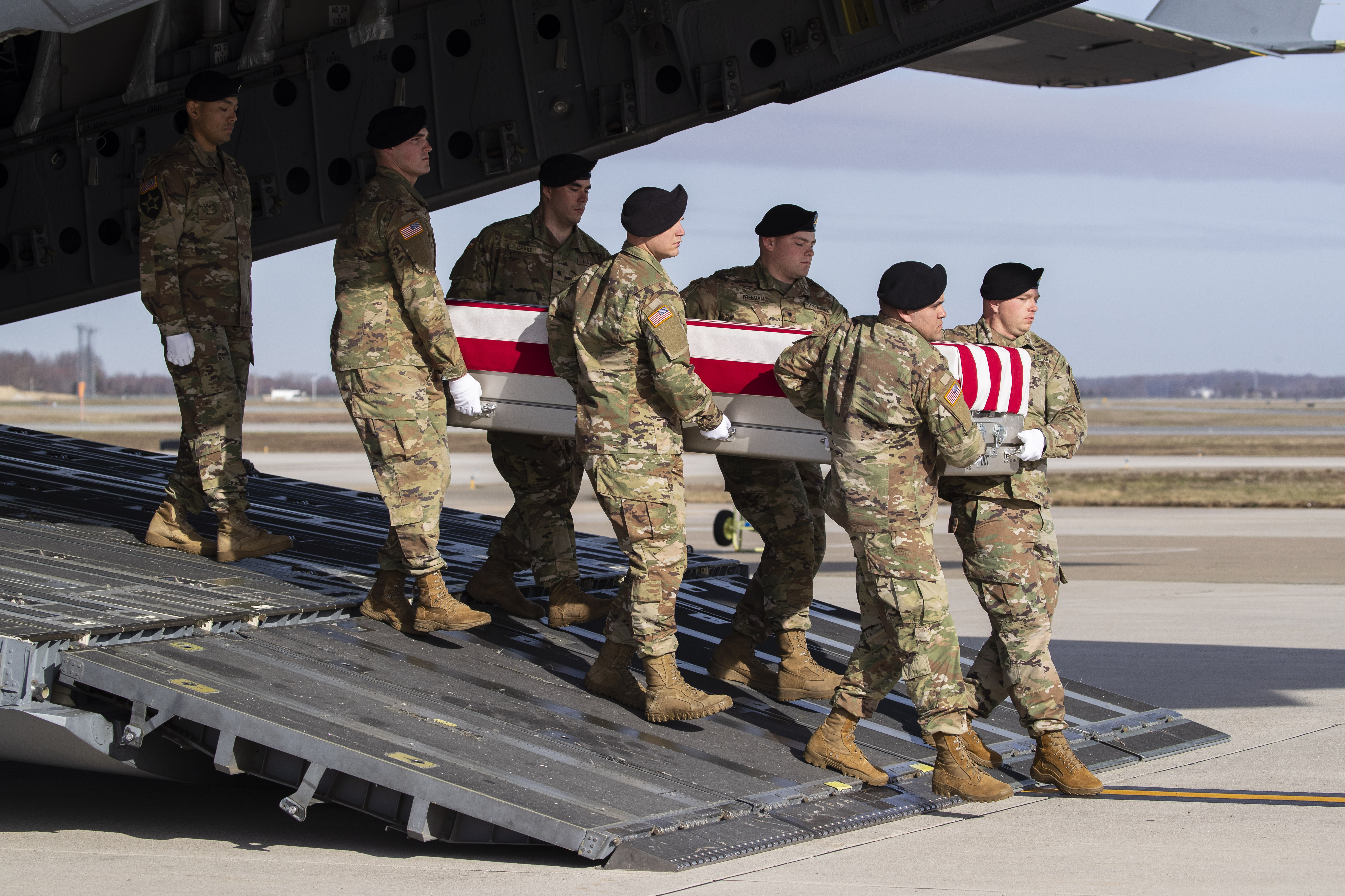 In this Dec. 25, 2019, file photo, an Army carry team moves a transfer case containing the remains of U.S. Army Sgt. 1st Class Michael Goble, at Dover Air Force Base, Del. Goble, a U.S. Special Forces soldier who died in Afghanistan this week.