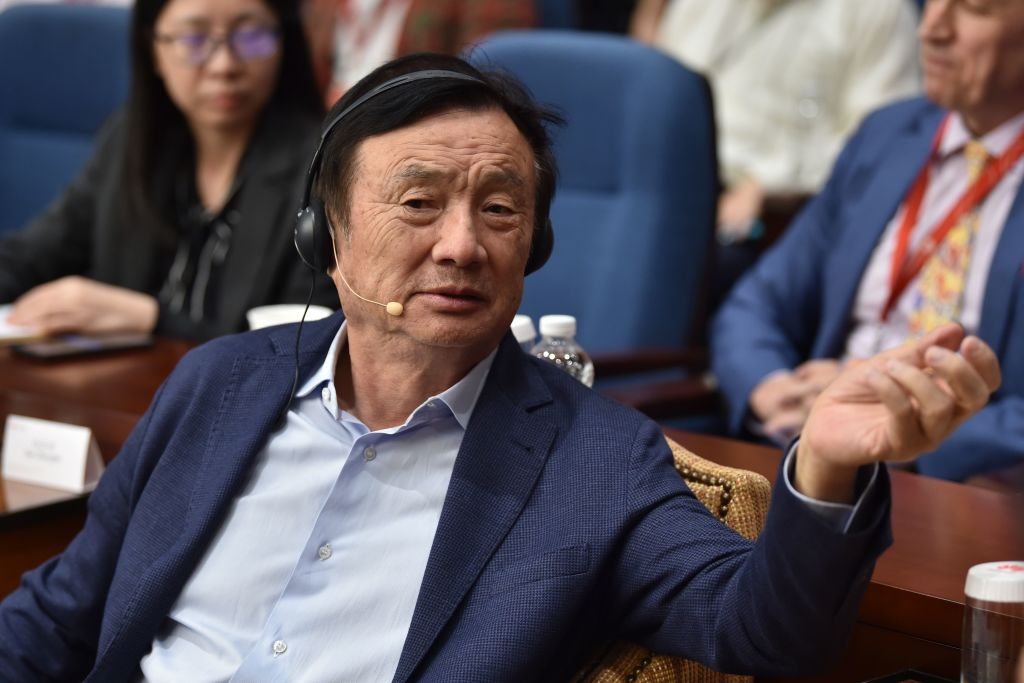 Huawei founder and CEO Ren Zhengfei (C) gestures as he hosts a panel discussion on technology, markets and enterprise in Shenzhen on June 17, 2019.