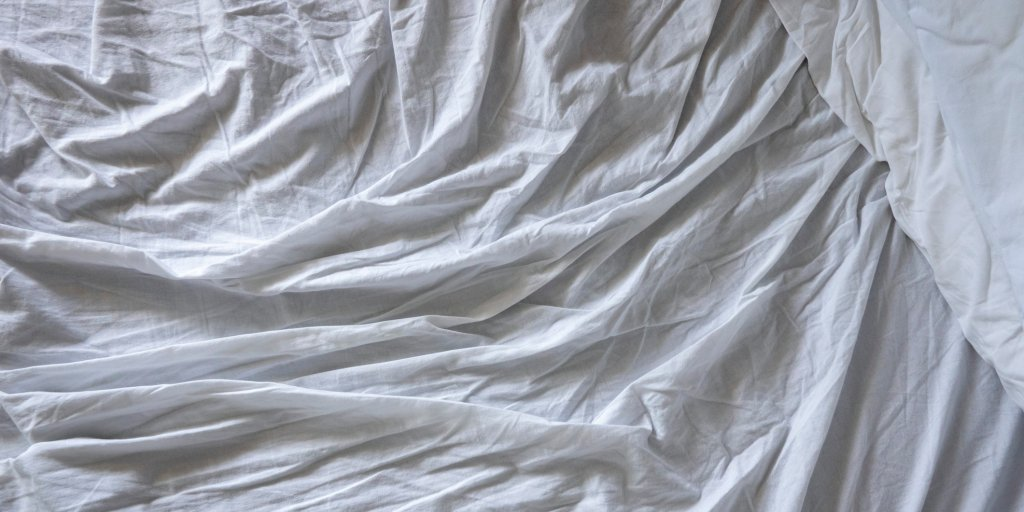 Not Everyone Is Comfortable With This Woman's Post-It Note-Like Hack to Avoid Folding Fitted Sheets