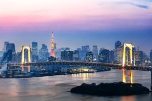 Rainbow bridge and skyline at sunset, Tokyo, Japan