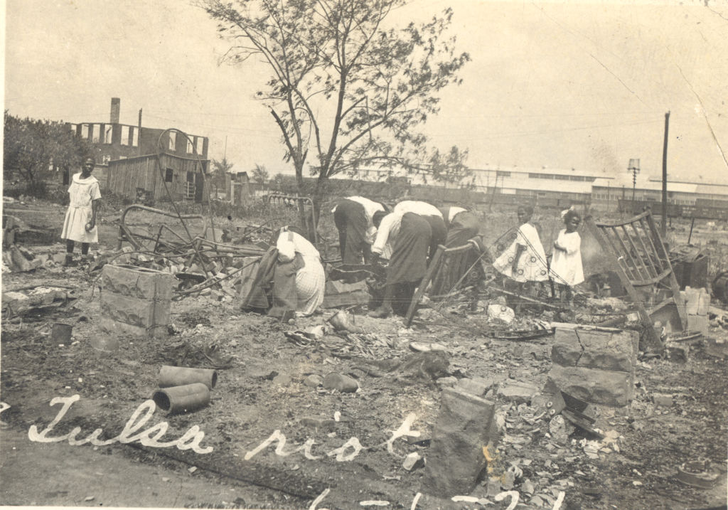 Photograph of people searching through rubble after the Tulsa Race Riot, Tulsa, Oklahoma, June 1921.