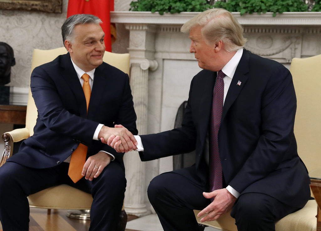 U.S. President Donald Trump shakes hands with Hungarian Prime Minister Viktor Orban during a meeting in the Oval Office on May 13, 2019 in Washington, DC. President Trump took questions on trade with China, Iran and other topics.