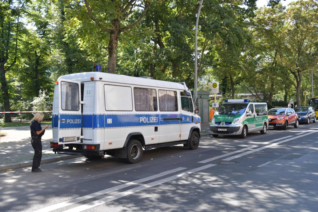 Picture taken on August 23, 2019 shows police cars parked close to the site of a crime scene in Berlin's Moabit district, where a man of Georgian origin was shot dead.