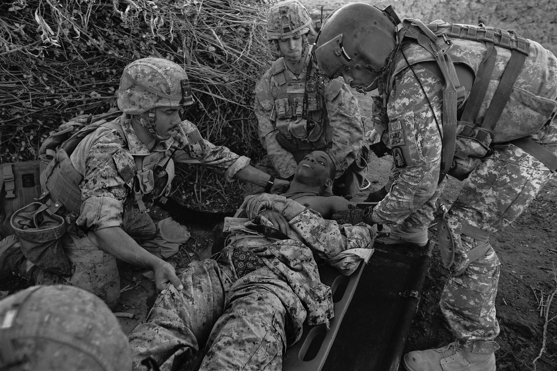 Medevac crew members prepare to evacuate a wounded Marine in Helmand province in 2010