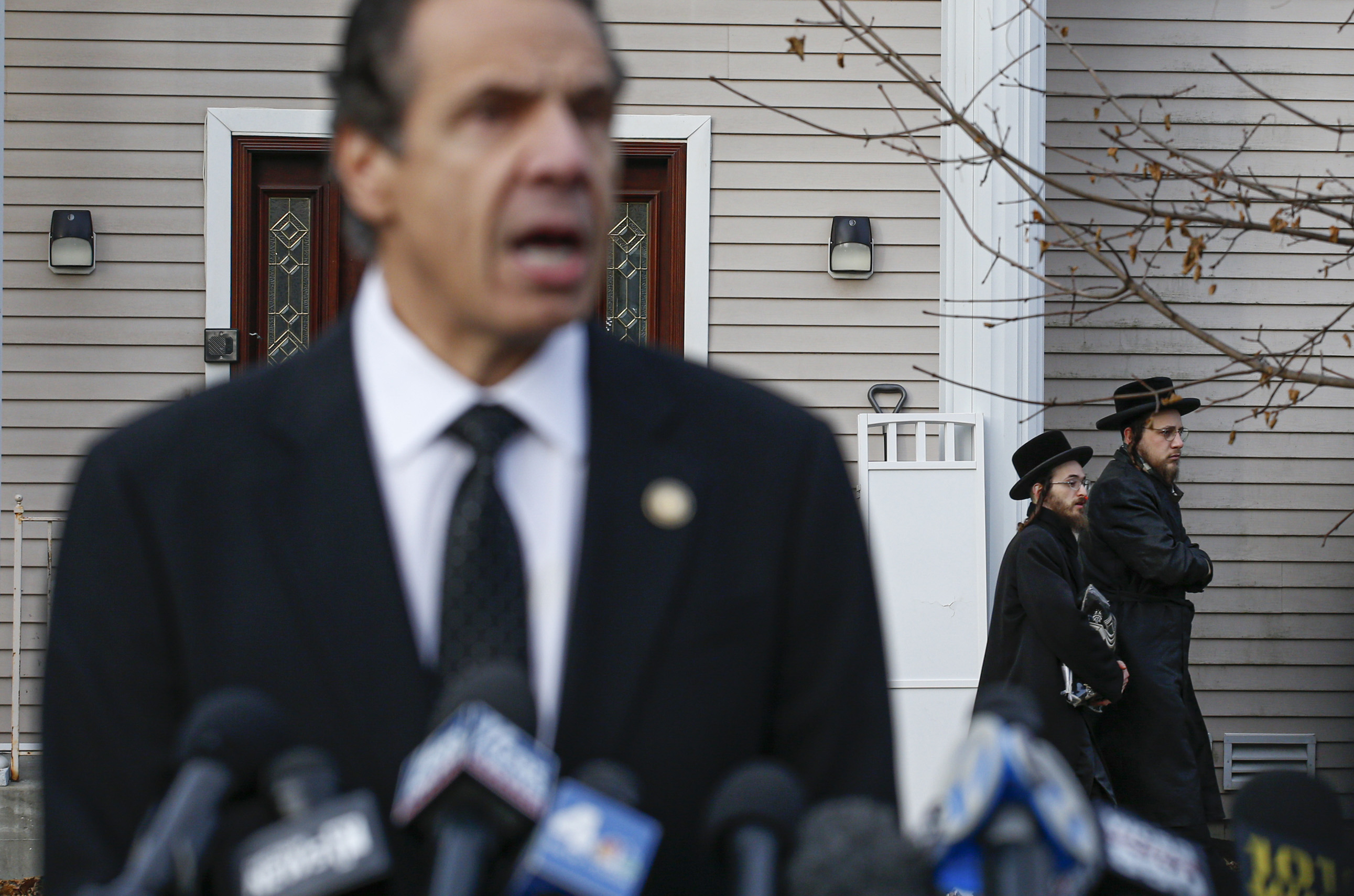 New York Governor Andrew Cuomo speaks to the media outside the home of Rabbi Chaim Rottenberg in Monsey, New York on Dec. 29, 2019.