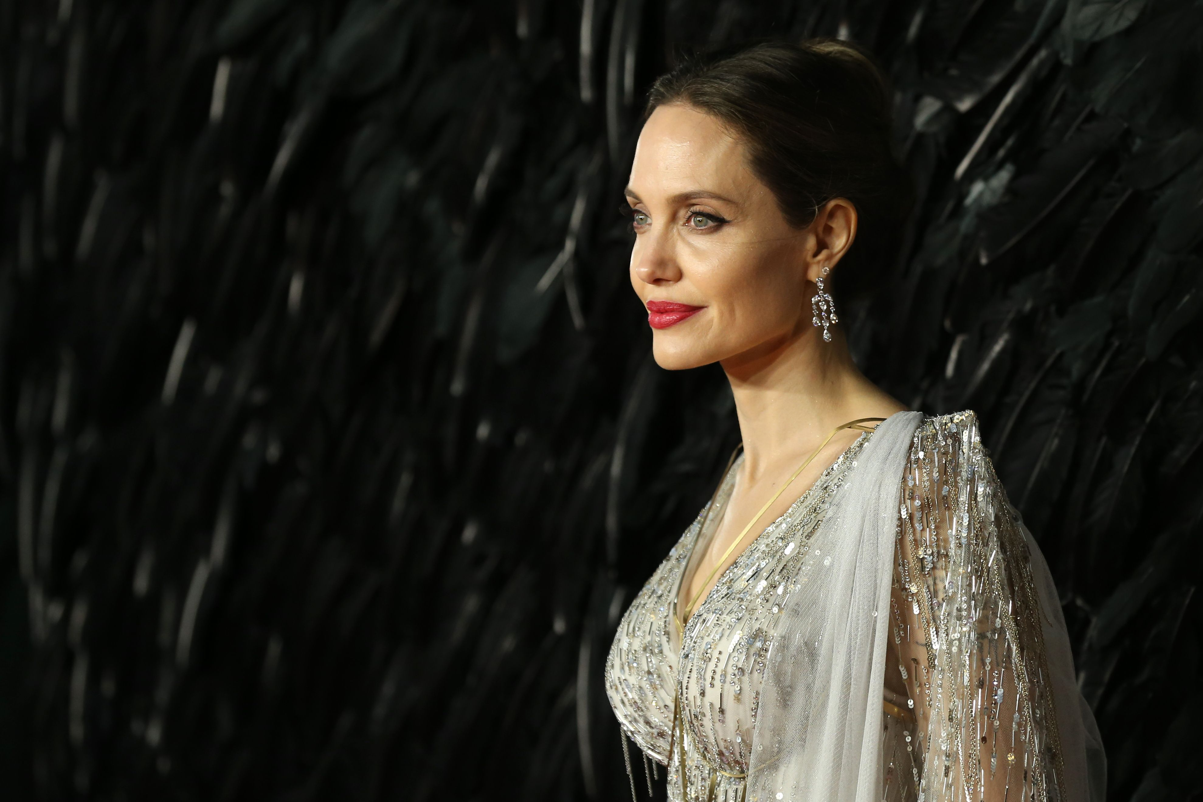 US actress Angelina Jolie poses on the red carpet upon arrival for the European premiere of the film  Maleficent:Mistress of Evil  in London on October 9, 2019. (Photo by ISABEL INFANTES / AFP) (Photo by ISABEL INFANTES/AFP via Getty Images)