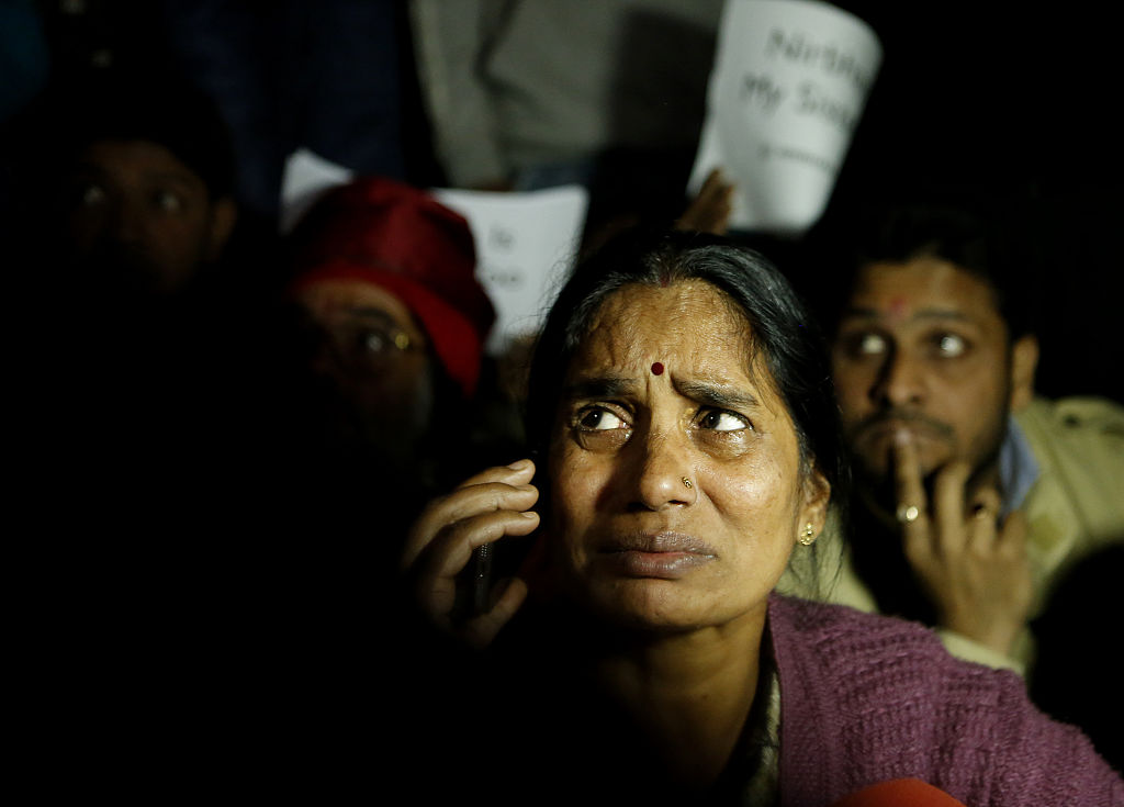 Mother of Nirbhaya breaks down during a protest against the release of juvenile convict of the 16 December gang-rape, along with student activists at Jantar Mantar on December 20, 2015 in New Delhi, India.