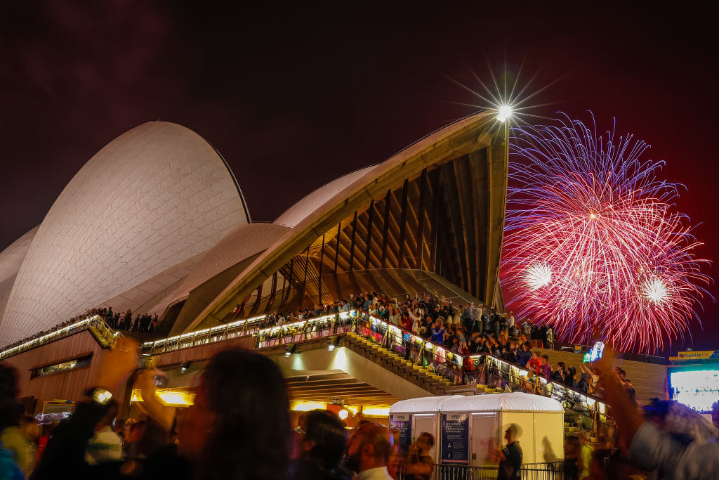 Fireworks explode over the Sydney Harbour Bridge and Sydney Opera House during the midnight display during New Year's Eve celebrations on January 01, 2020 in Sydney, Australia.