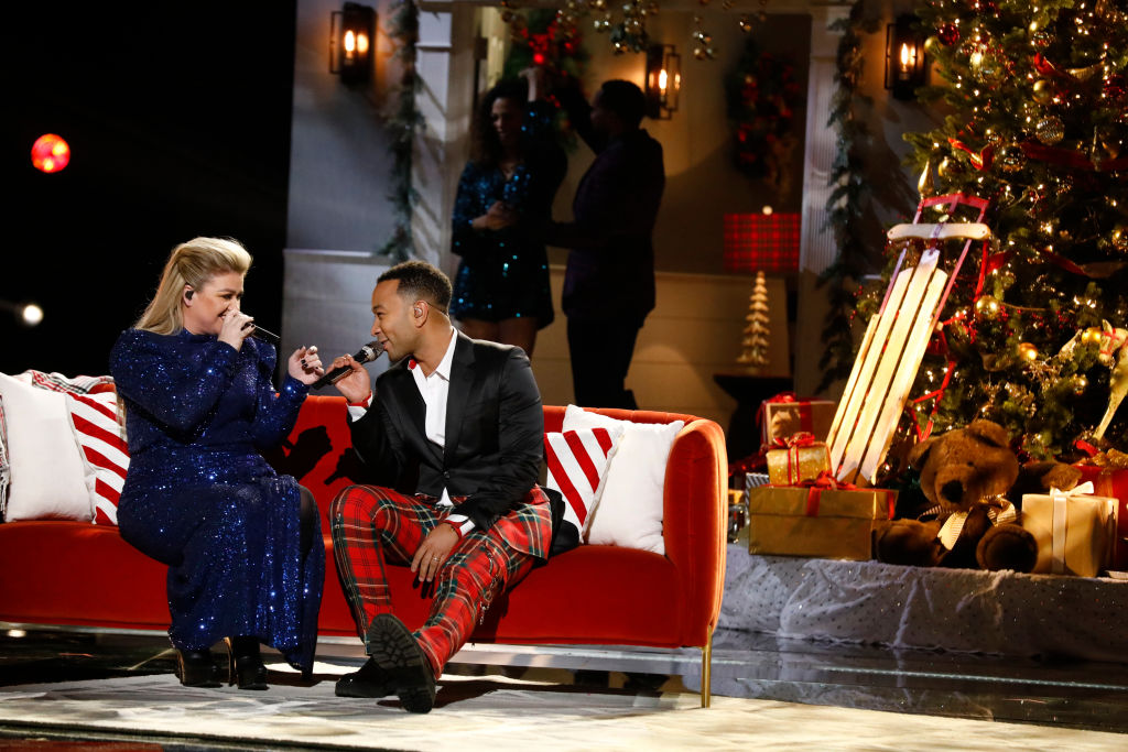 Kelly Clarkson and John Legend performing their new cover of  Baby, It's Cold Outside  on The Voice on Dec. 3.
