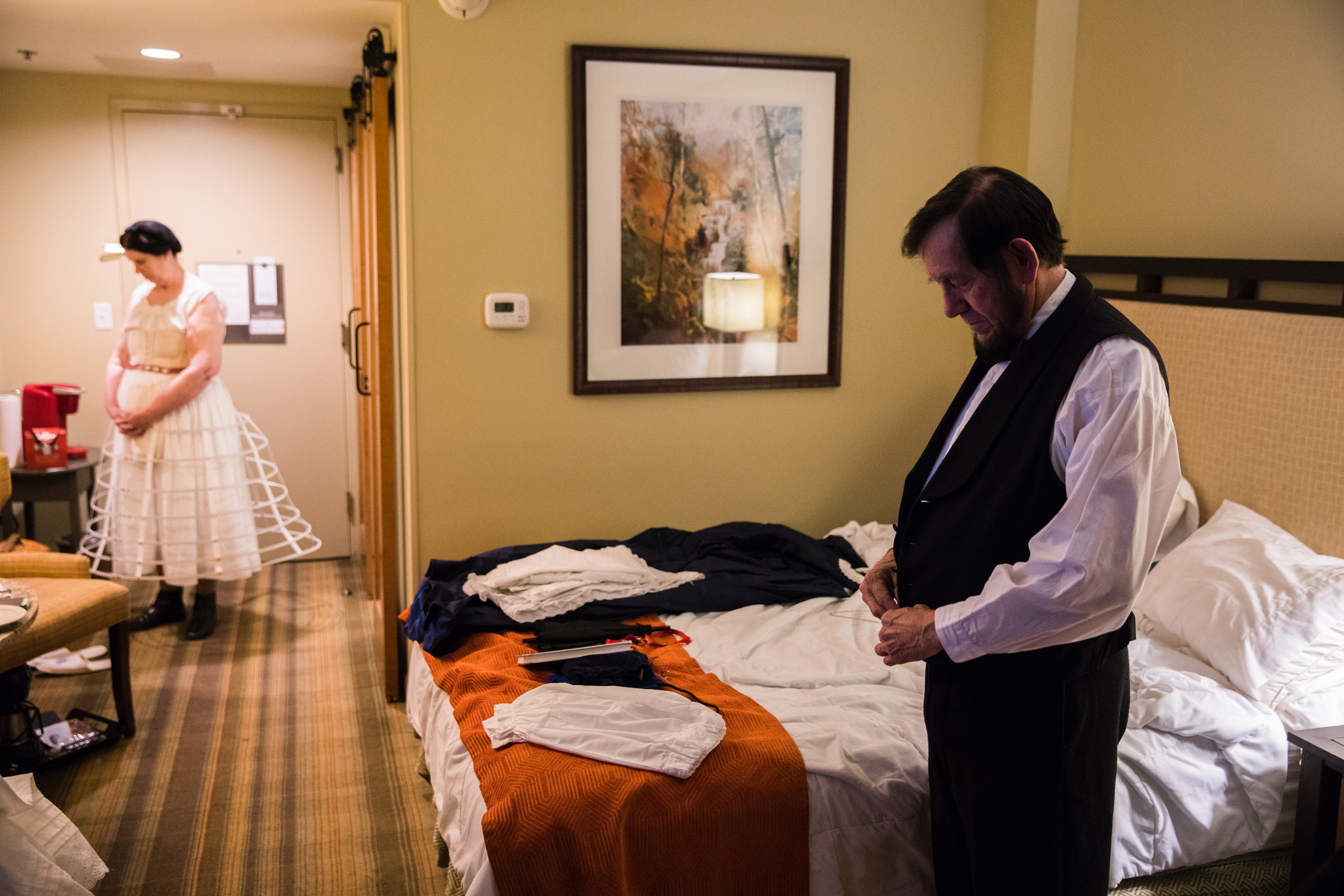 Tom and Sue Wright of Oak Ridge, Tenn., who have been portraying Abe and Mary Lincoln for 10 years, get dressed in the pre-dawn hours in Dawsonville, Ga., on April 13.