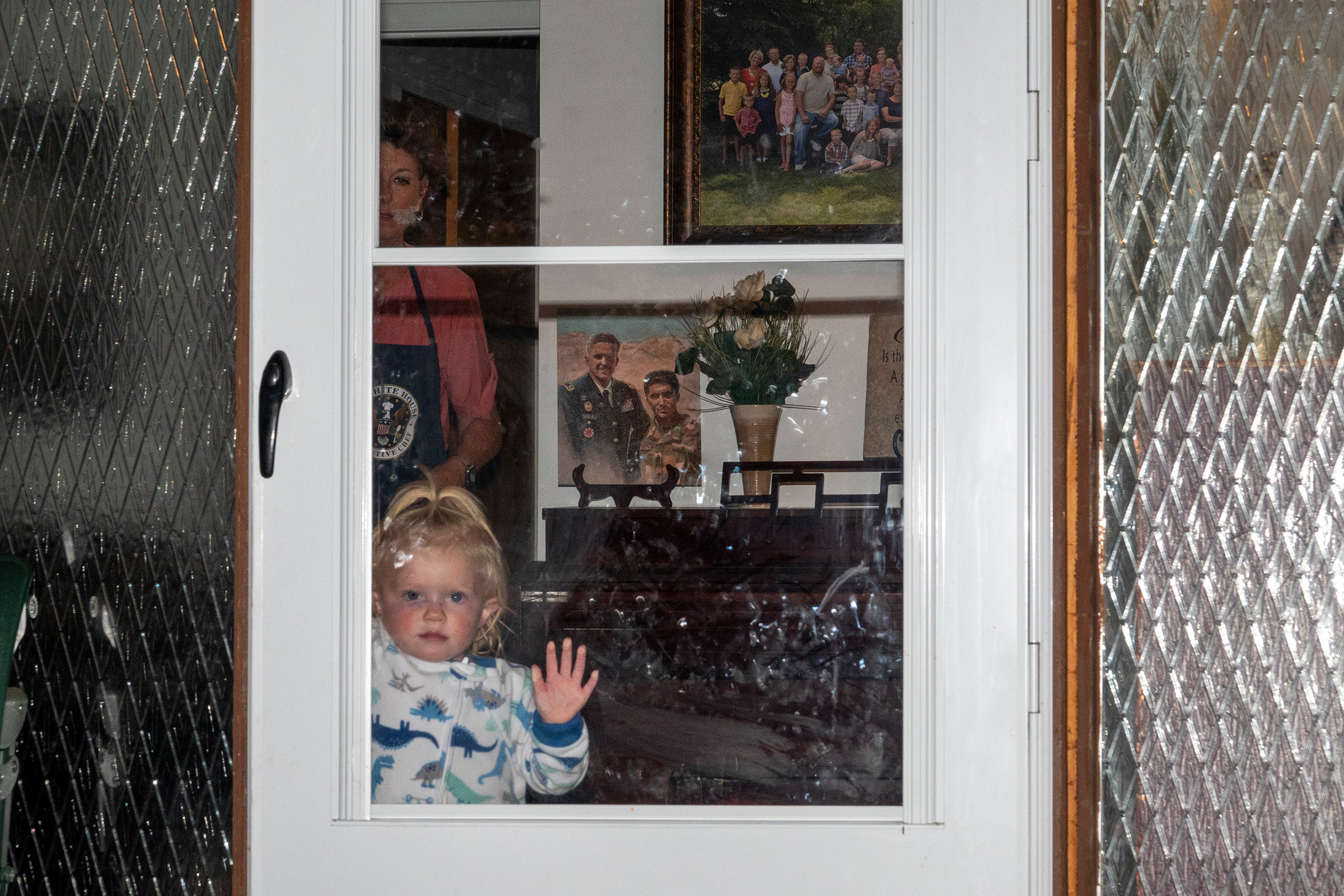 Caroline Taylor at her grandmother's house in North Ogden, Utah, in September. Her father, Brent Taylor, was killed while serving in Afghanistan in November 2018. Oct. 21 issue.