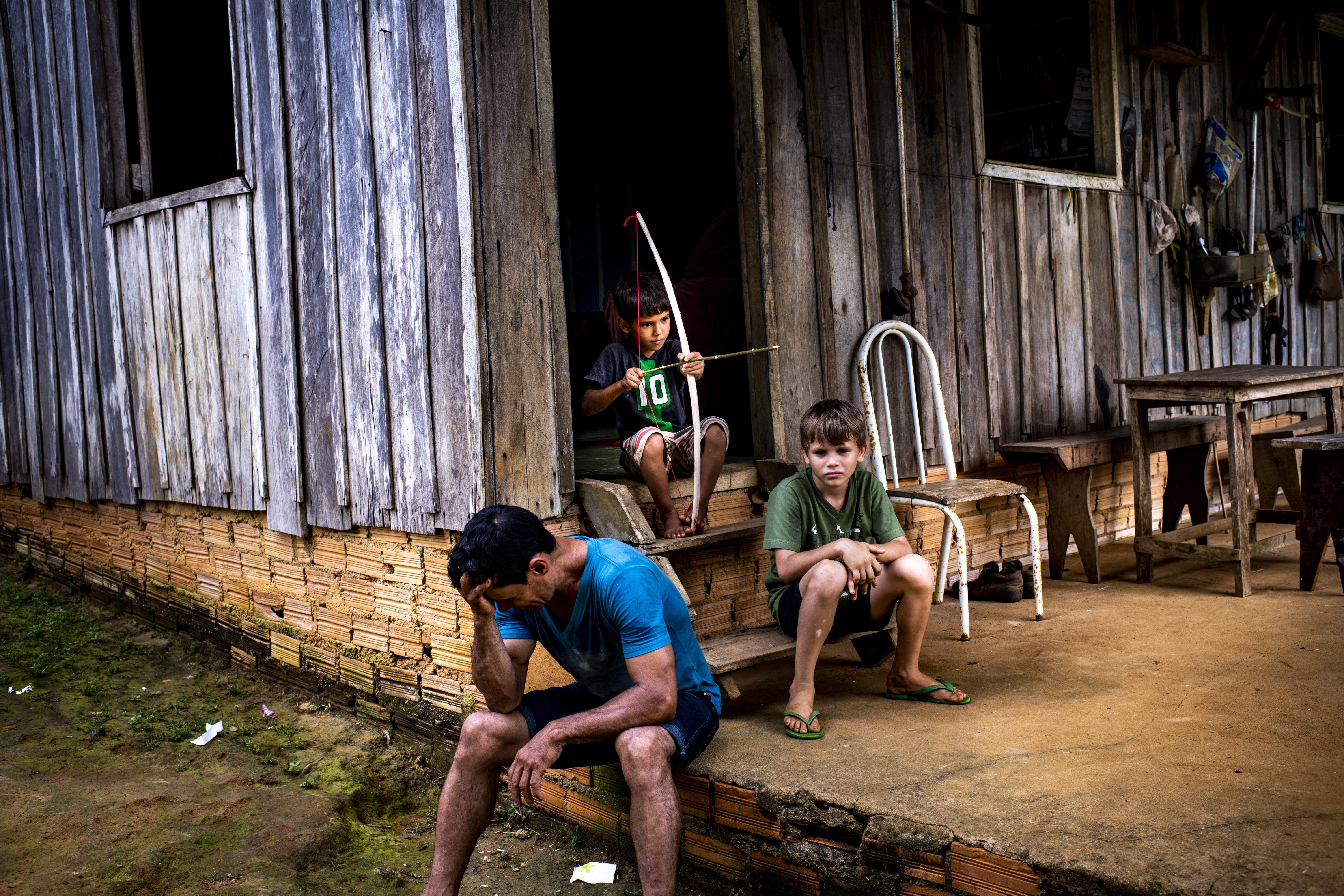 Rubber tappers work on government-protected land, which provides a bulwark against deforestation. But one rubber tapper, Marcelo Firmiano da Silva, photographed with two sons on Feb. 16, says 18 of his colleagues have been killed since 2002. Sept. 23 issue.