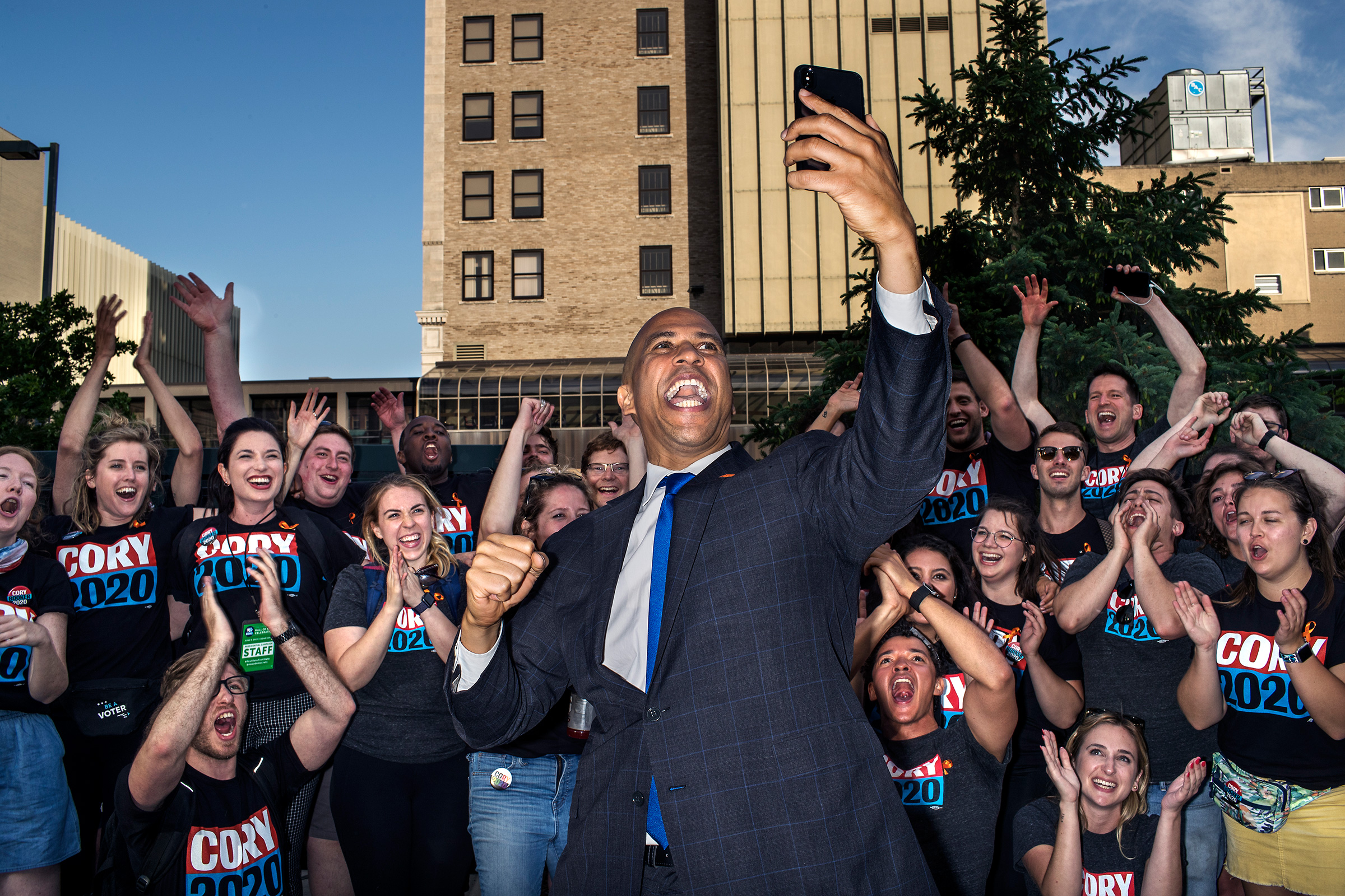 Sen. Cory Booker greets supporters in Cedar Rapids before the Iowa Democratic Party's Hall of Fame event on June 9. July 29 issue.