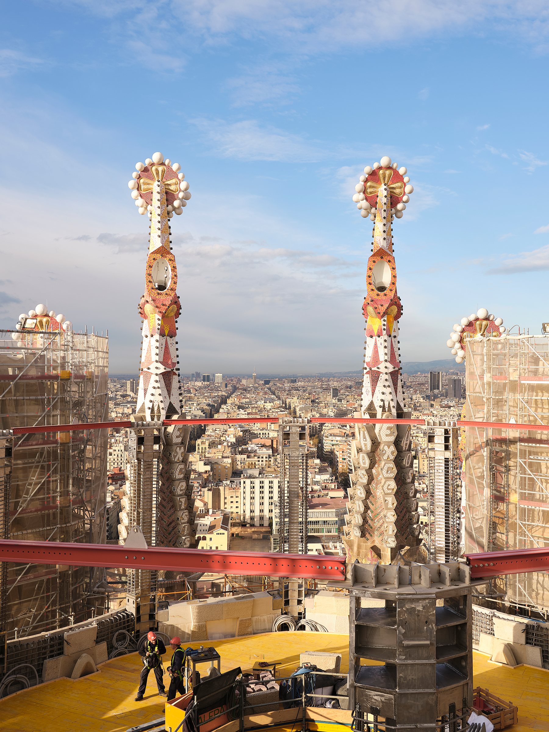 Workers atop the Sagrada Familia, one of the world's longest-running construction projects, in Barcelona in March. July 8 issue.