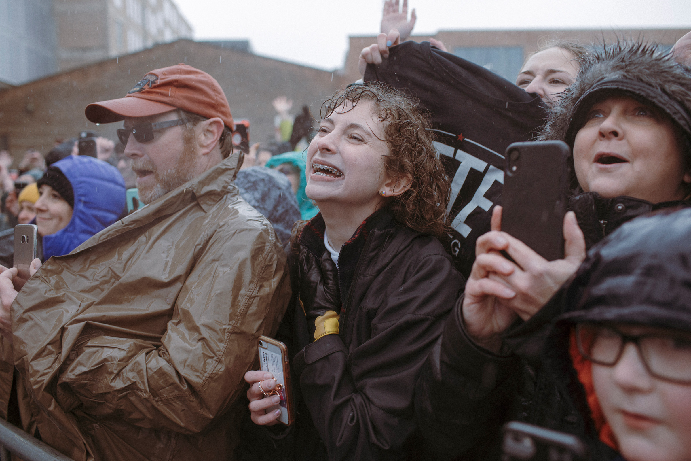 Supporters wait in the rain on April 14 for Pete Buttigieg's presidential campaign announcement in South Bend. May 13 issue.
