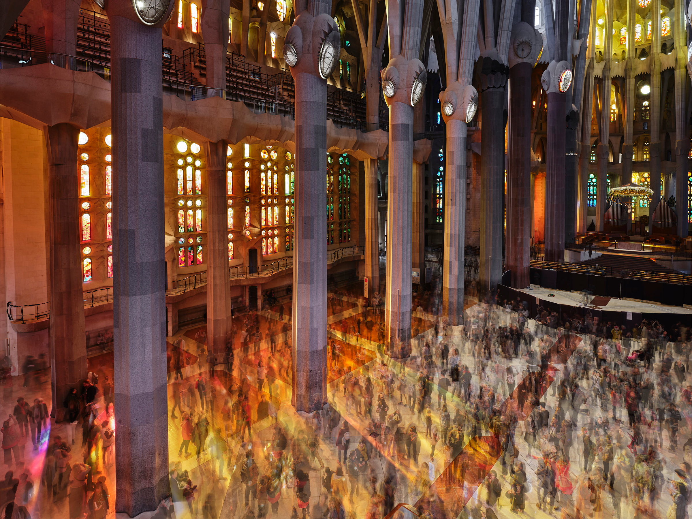 The entry fees of roughly 4 million visitors to the Sagrada Familia each year help provide the money needed to finish construction. On March 18, visitors walk through the nave. July 8 issue.