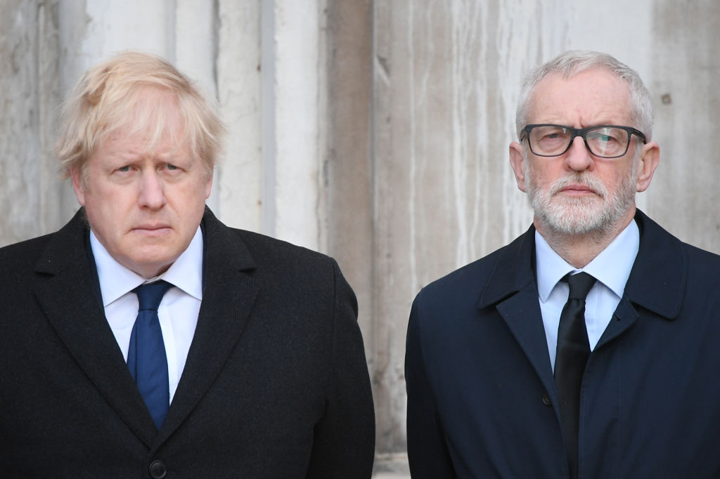 Britain's Prime Minister Boris Johnson (L) and opposition Labour party leader Jeremy Corbyn take part in a vigil at the Guildhall in central London to pay tribute to the victims of the London Bridge terror attack on Dec. 2, 2019.