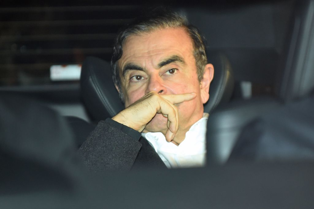 Former Nissan chairman Carlos Ghosn leaves his lawyers' offices after he was released earlier in the day from a detention centre after posting bail in Tokyo on March 6, 2019.