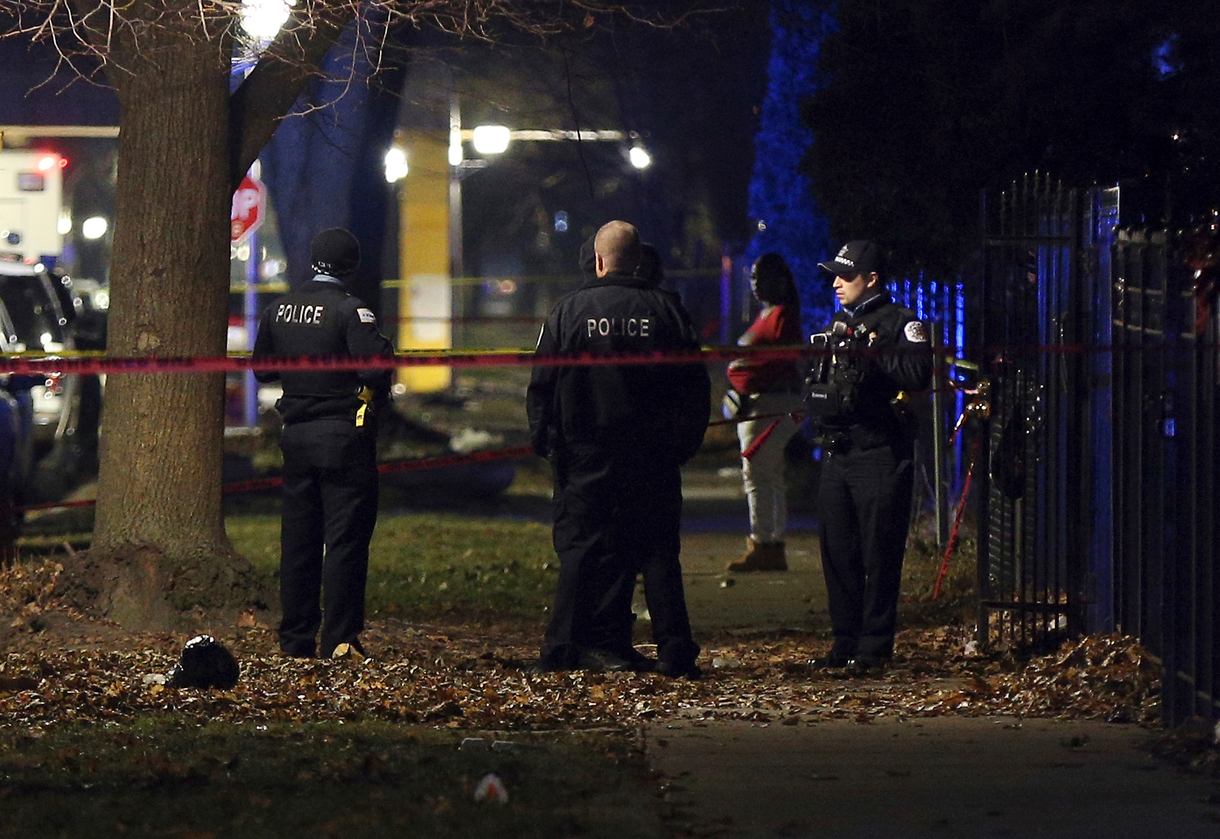 Police officers guard a crime scene in the 5700 block of S. May Street in Chicago after a shooting on Dec. 22, 2019.