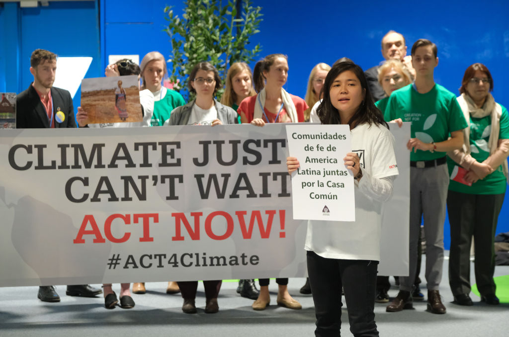 Members of Christian youth groups from the Americas hold a demonstration at the COP25 climate conference in Madrid, Spain on Dec. 3, 2019.