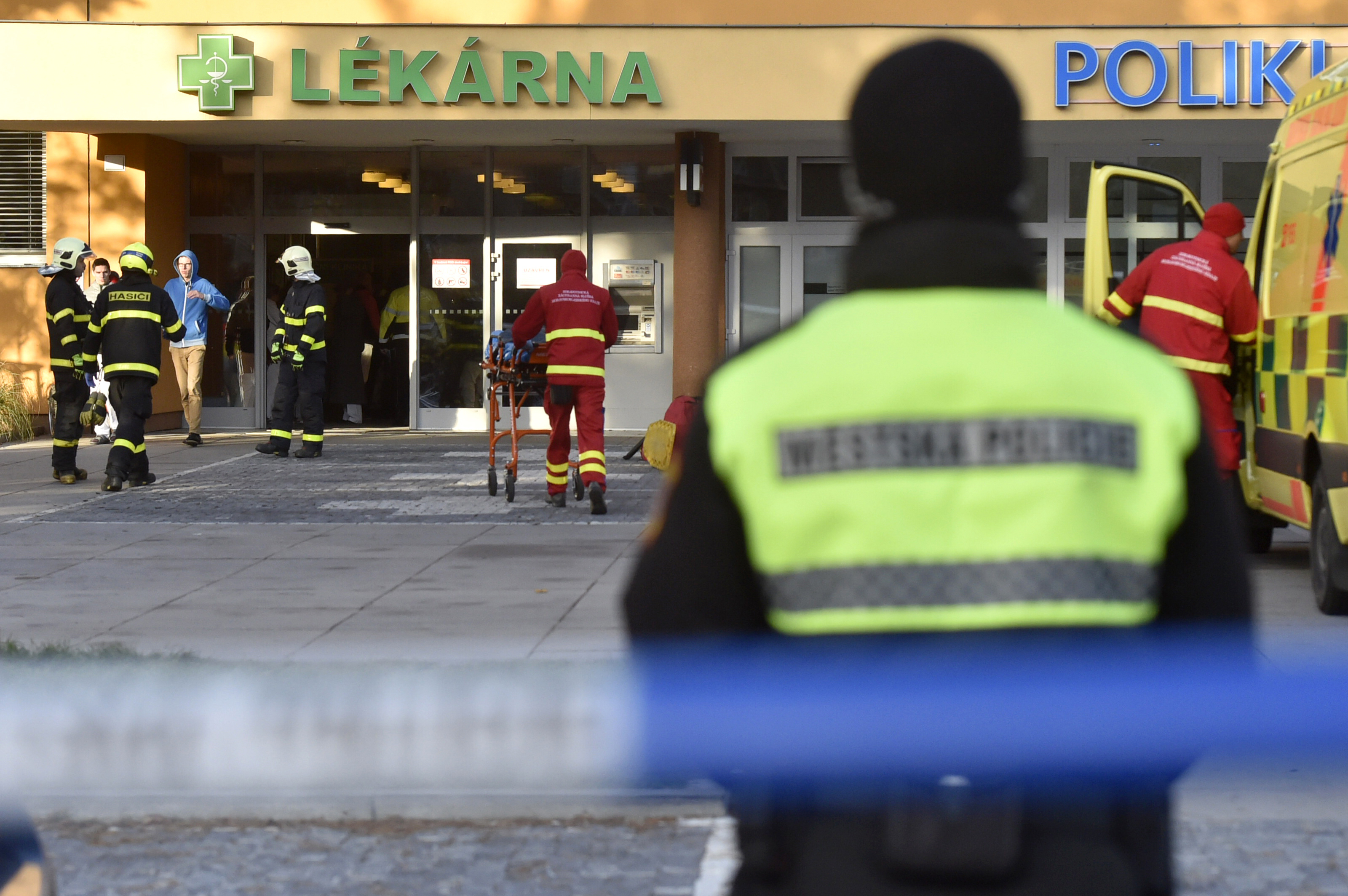 Firefighters, police officers and paramedics in front of the Ostrava Teaching Hospital, after a shooting incident in Ostava, Czech Republic, on Dec. 10, 2019.