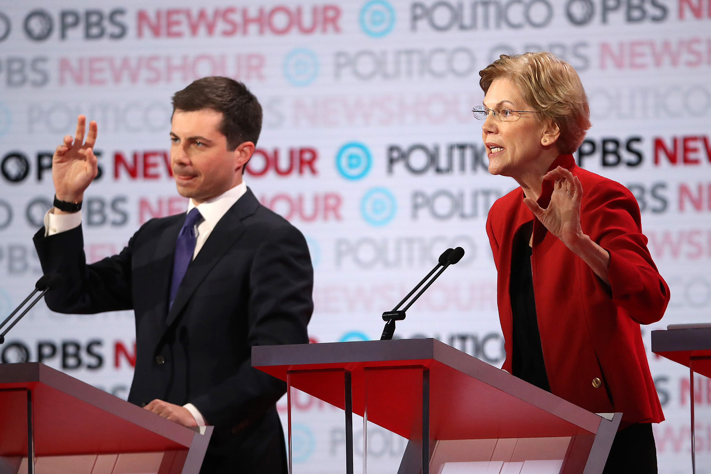 Sen. Elizabeth Warren (D-MA) speaks as South Bend, Indiana Mayor Pete Buttigieg listens during the Democratic presidential primary debate at Loyola Marymount University on Dec. 19, 2019 in Los Angeles, California.