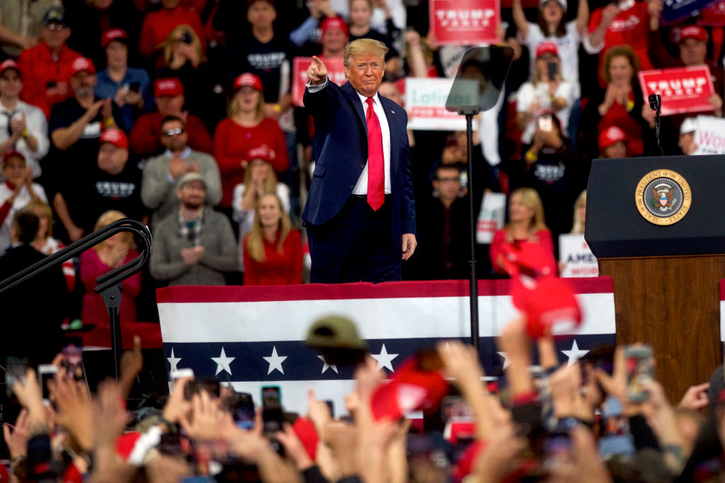 U.S. President Donald Trump takes the stage during a campaign rally in Hershey, Pennsylvania, on December 10, 2019.