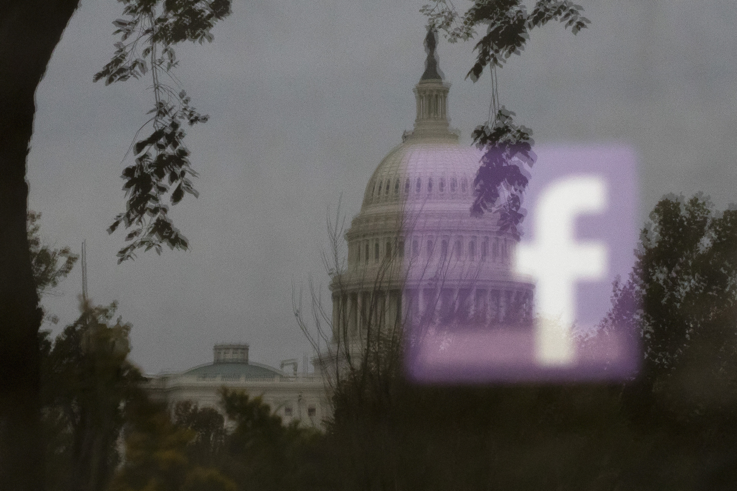 A Facebook logo is reflected on an advertisement board outside the Capitol in Washington, on Oct. 25, 2018.