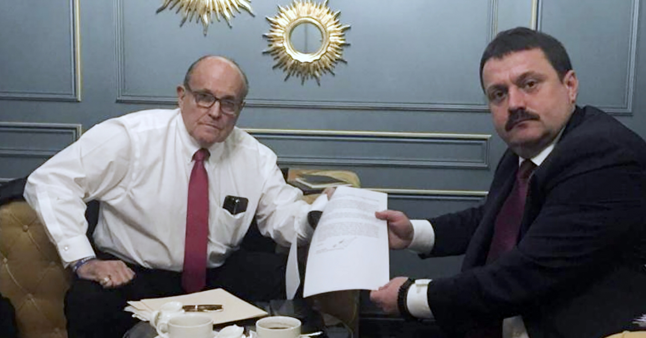 In this handout photo provided by Adriii Derkach's press office, Rudy Giuliani, an attorney for U.S President Donald Trump, left, meets in Kyiv, Ukraine, on Dec. 5, 2019 with Derkach, who was later named an  active Russian agent  by the U.S. government.