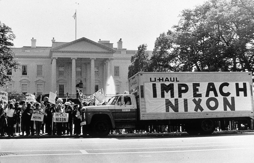 A demonstration outside the Whitehouse in support of the impeachment of President Nixon (1913 - 1994) following the Watergate revelations.
