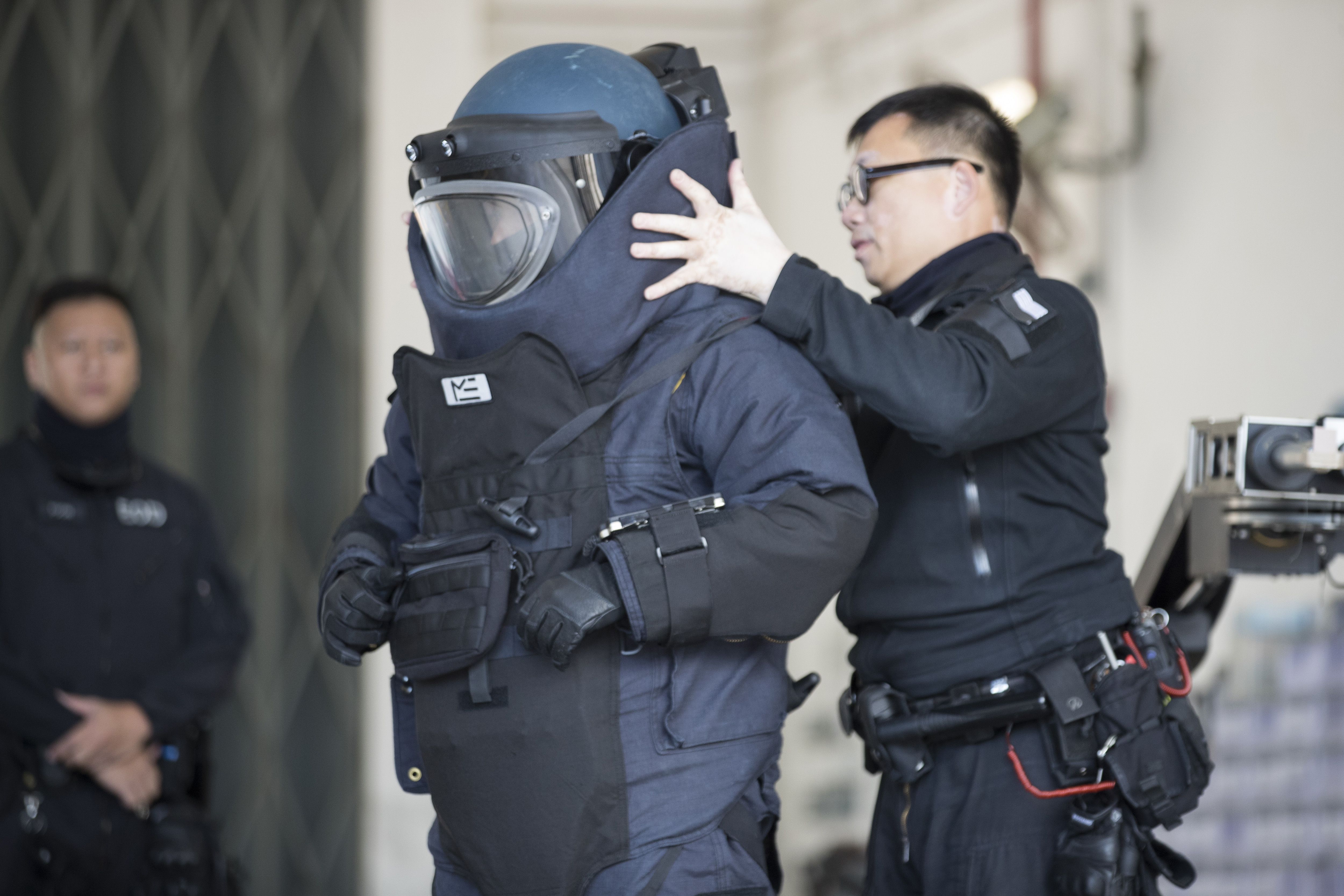 A police officer from the bomb disposal squad putting on protective gear during a demonstration for media in Hong Kong on Dec. 6, 2019.