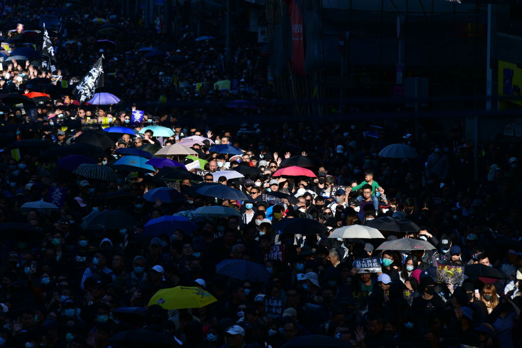People take part in a pro-democracy rally from Victoria Park to Chater Road in Hong Kong on Dec. 8, 2019.