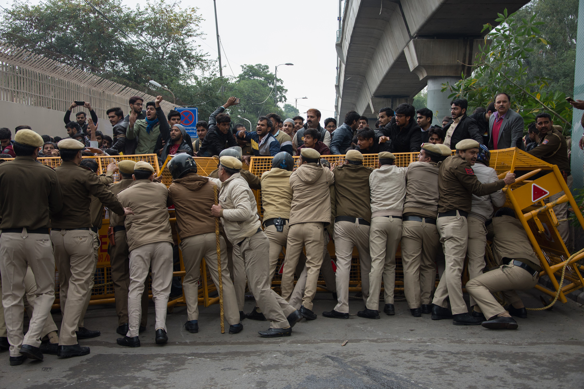 Protests against the controversial Citizenship Amendment Act turned violent when Delhi Police shot tear gas and beat students at Jamia Millia Islamia University in Delhi, India on Dec. 13, 2019.