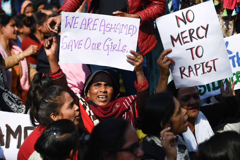 Social activists and supporters shout slogans to protest against the alleged rape and murder of a 27-year-old veterinary doctor in Hyderabad, during a demonstration in New Delhi on December 3, 2019.