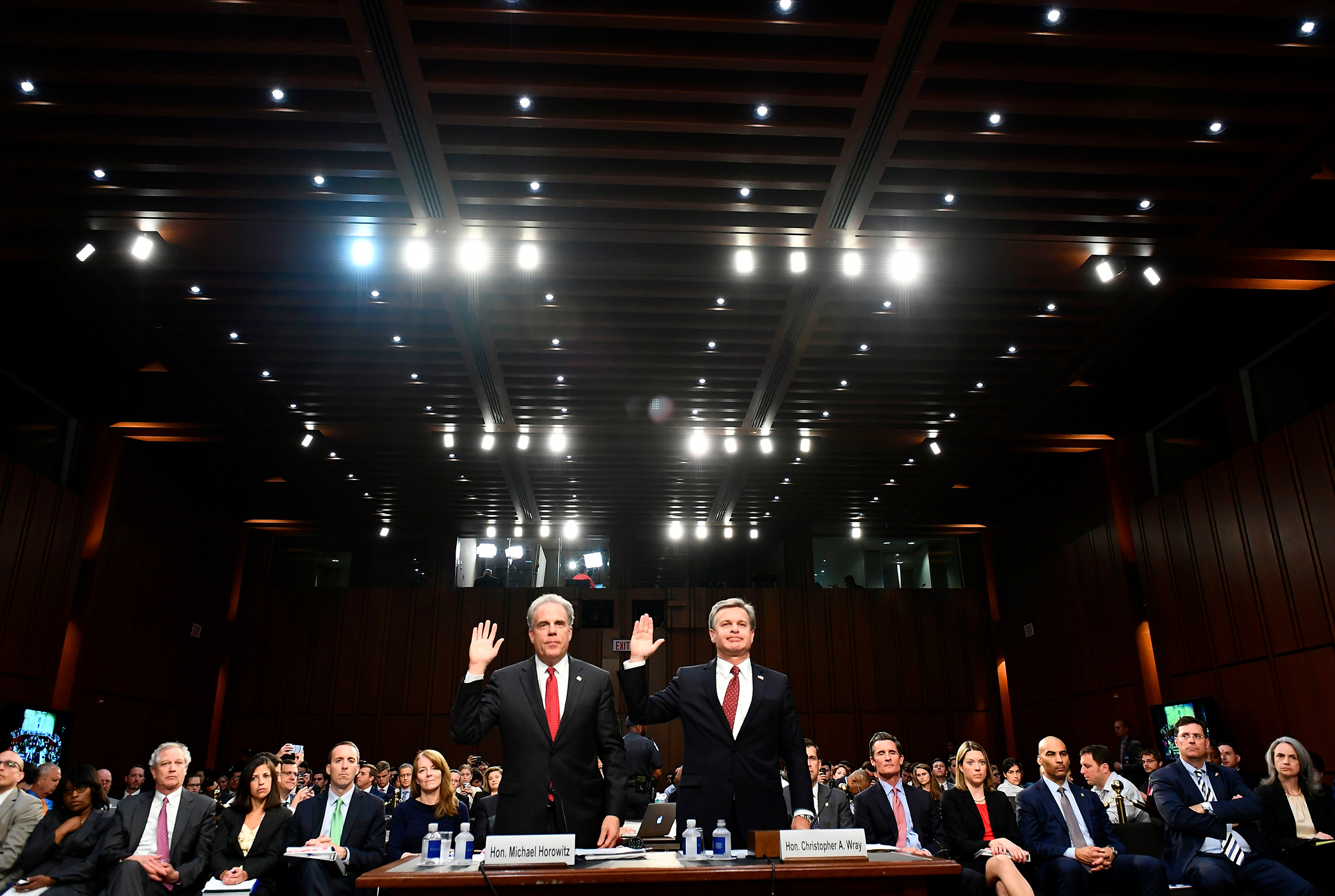 Justice Department Inspector General Michael Horowitz, left, and FBI Director Christopher Wray take an oath before testifying to the Senate Judiciary Committee in Washington, DC on June 18, 2018.