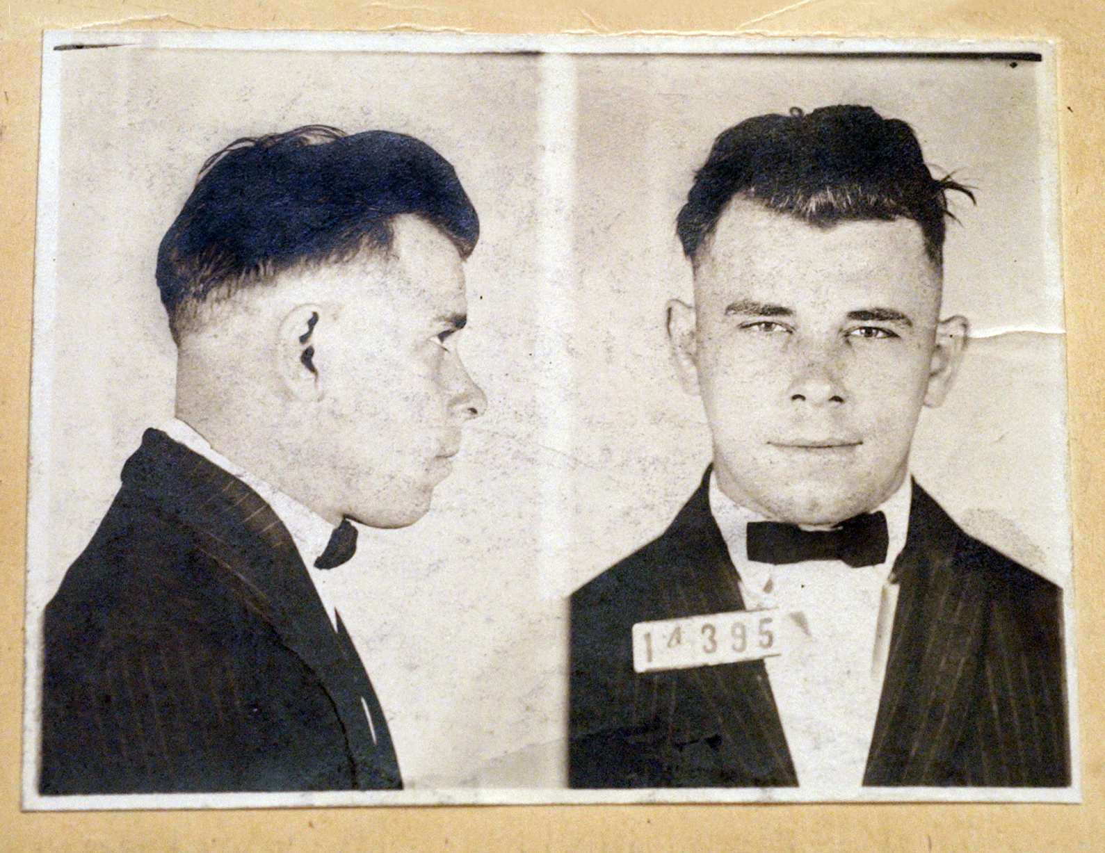 FILE - This undated file photo shows Indiana Reformatory booking shots of John Dillinger, stored in the state archives. A judge will hear an Indianapolis cemetery's bid Wednesday, Nov. 4, 2019, to dismiss a lawsuit filed by a relative of the 1930s gangster  who wants to exhume Dillinger's gravesite to determine if the notorious criminal is actually buried there.