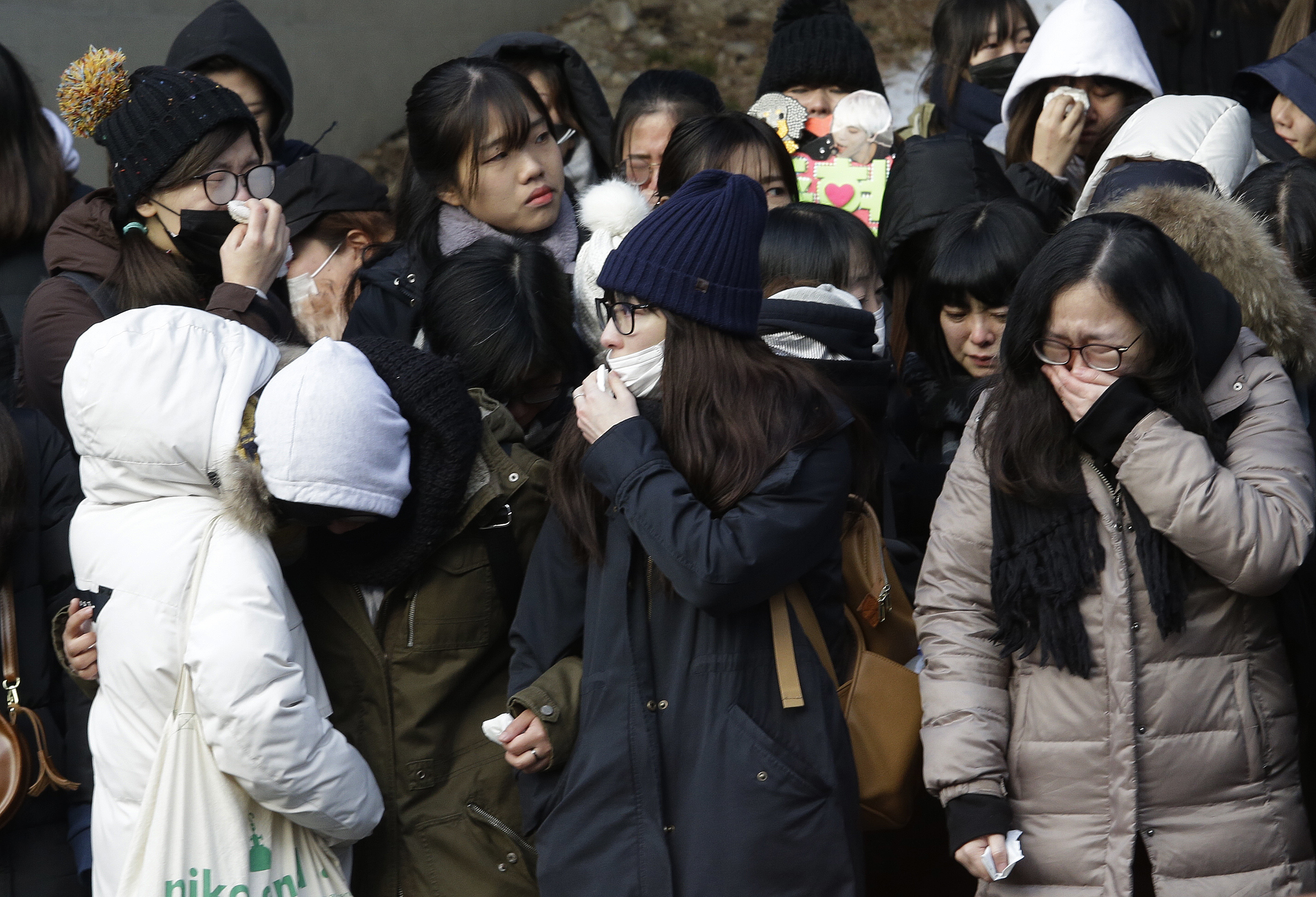 Fans react during the funeral of late South Korean singer Kim Jong-hyun, better known by the stage name Jonghyun, a member of South Korean K-pop group SHINee, in Seoul, South Korea on Dec. 21, 2017.