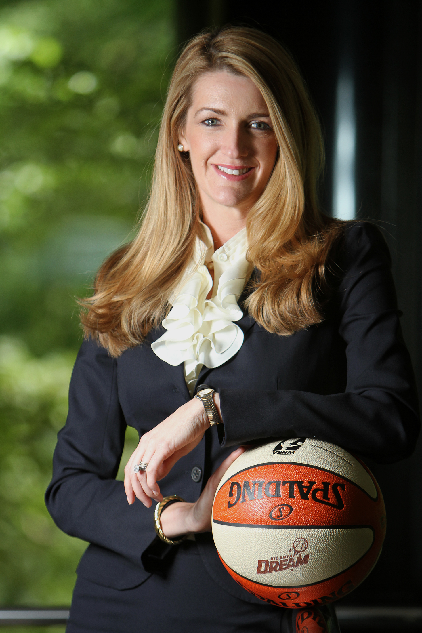 Kelly Loeffler pictured on May 24, 2011. She bought into the Atlanta Dream woman's basketball franchise partly to push players to see sports as paving the way to success all the way up the corporate ladder.