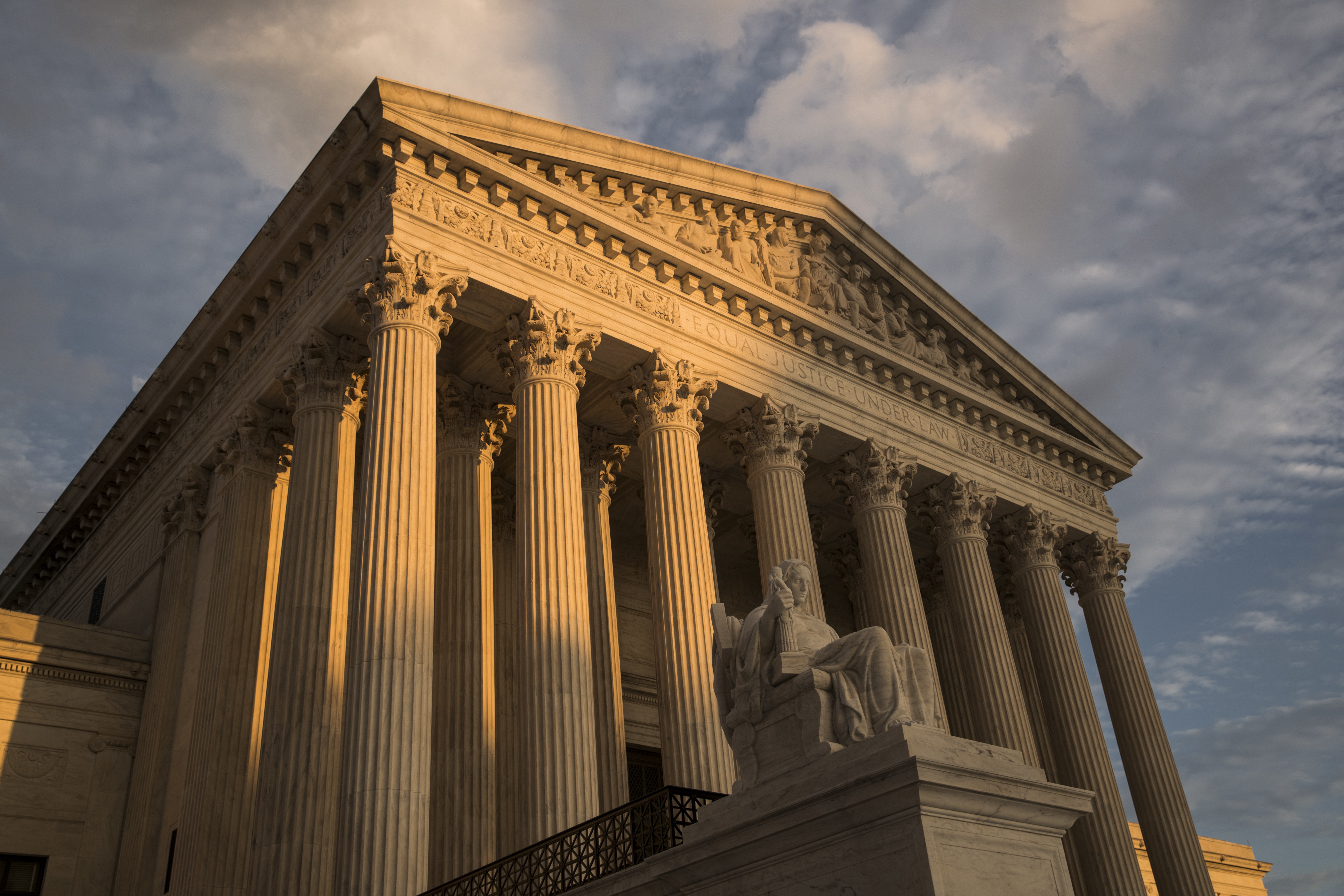 In this Oct. 10, 2017, file photo, the Supreme Court in Washington, at sunset. The Supreme Court has left in place a Kentucky law requiring doctors to perform ultrasounds and show fetal images to patients before abortions.