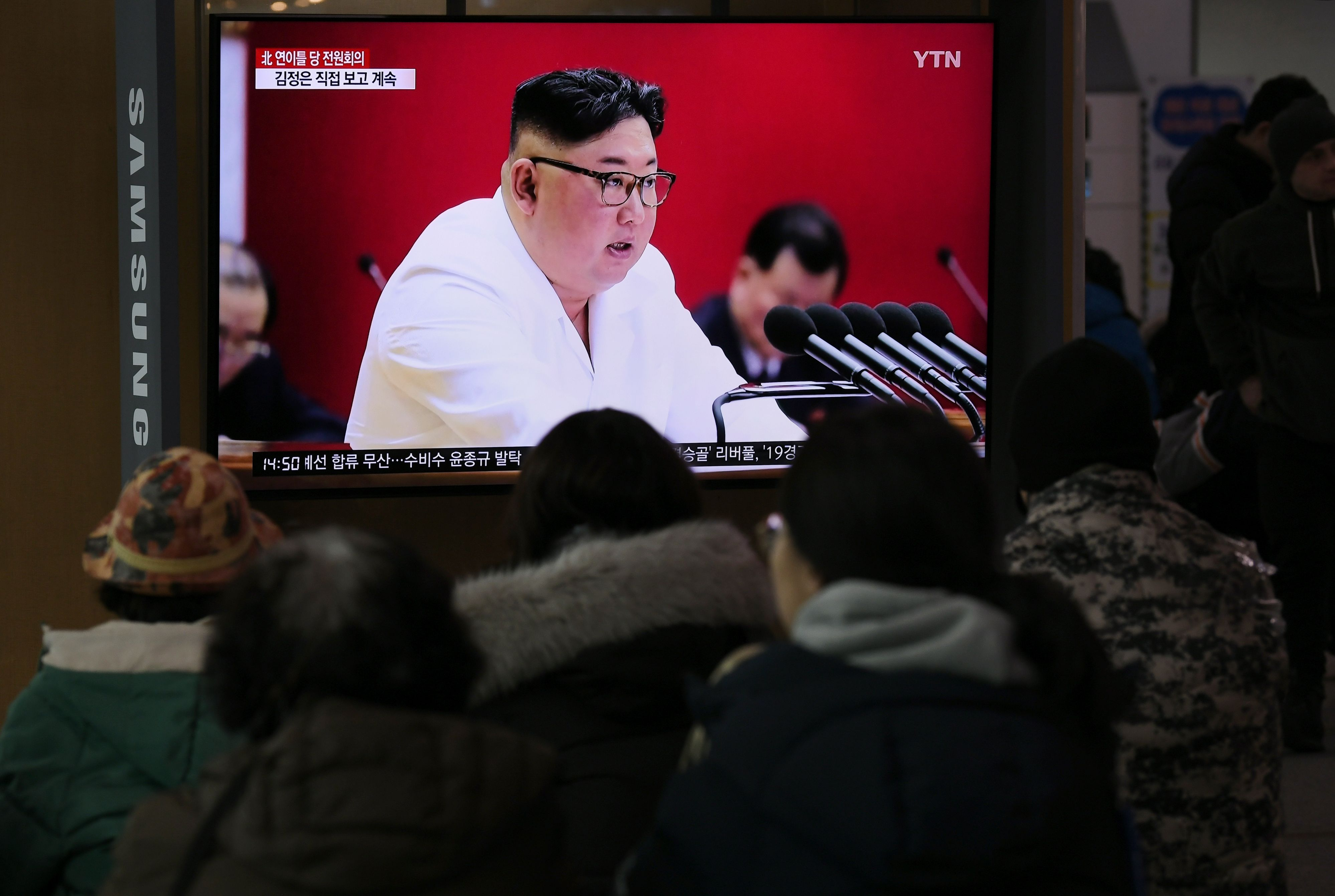 People watch a television news program showing  North Korean leader Kim Jong Un in Seoul on Dec. 30, 2019.