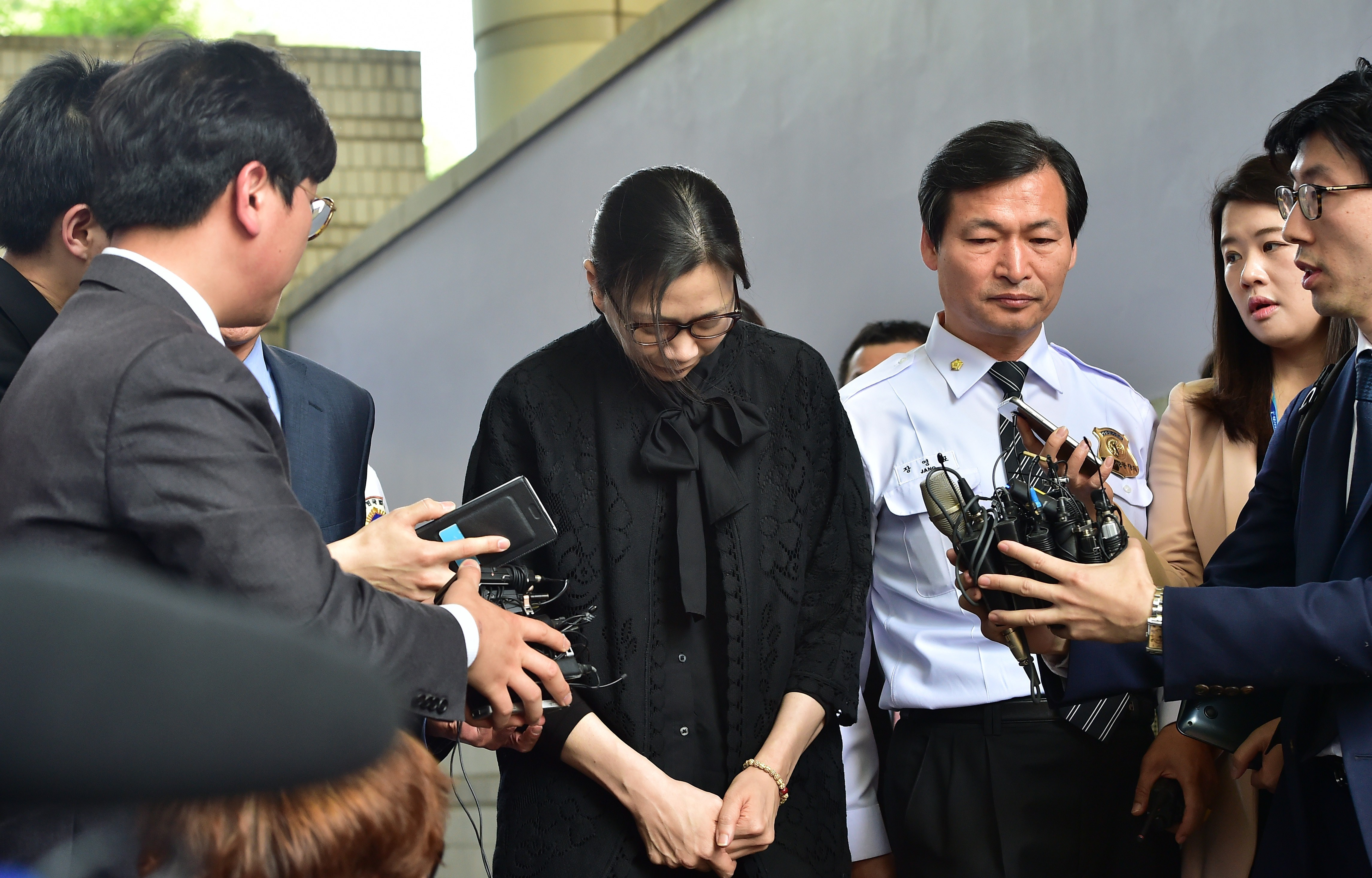 Former Korean Air executive Cho Hyun-Ah (Heather Cho) is surrounded by journalists after she received a suspended jail sentence and was freed by a Seoul appeals court on May 22, 2015.