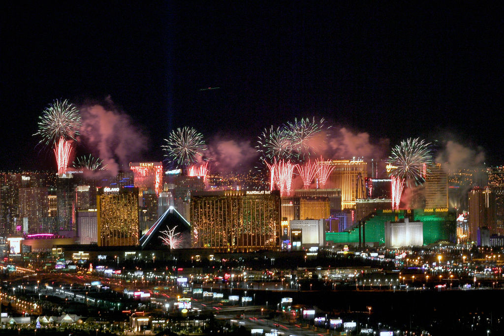 Fireworks illuminate the skyline over the Las Vegas Strip during an eight-minute-long pyrotechnics show put on by Fireworks by Grucci titled  America's Party 2020  during a New Year's Eve celebration on January 1, 2020 in Las Vegas, Nevada. About 400,000 visitors gathered to watch more than 80,000 fireworks shoot from the rooftops of seven hotel-casinos to welcome the new year.