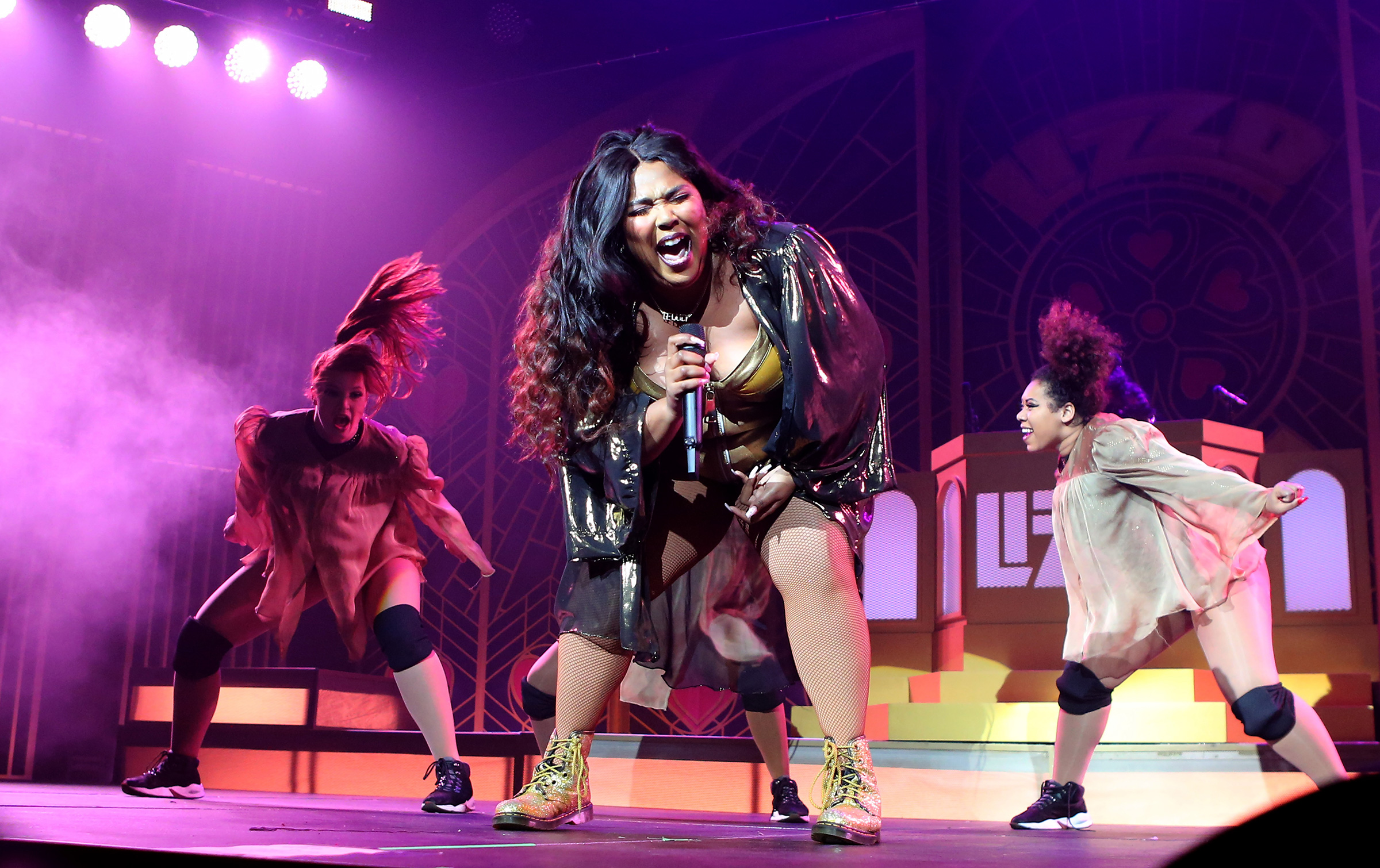 Lizzo performs with her dancers in London on Nov. 6