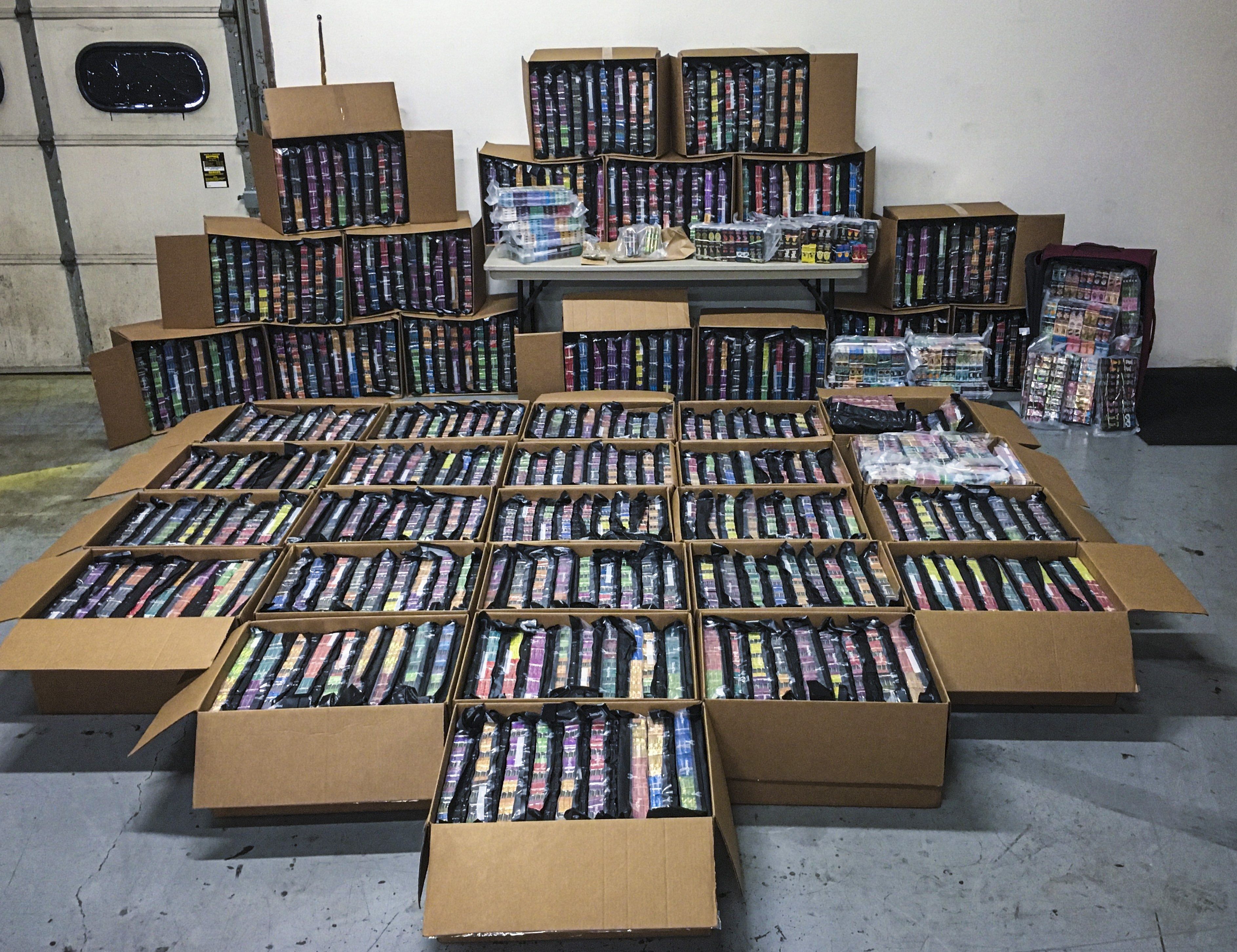This photo provided Nov. 7, 2019 shows some of the 75,000 THC vaping cartridges seized in drug busts by Minnesota's Northwest Metro Drug Task Force.