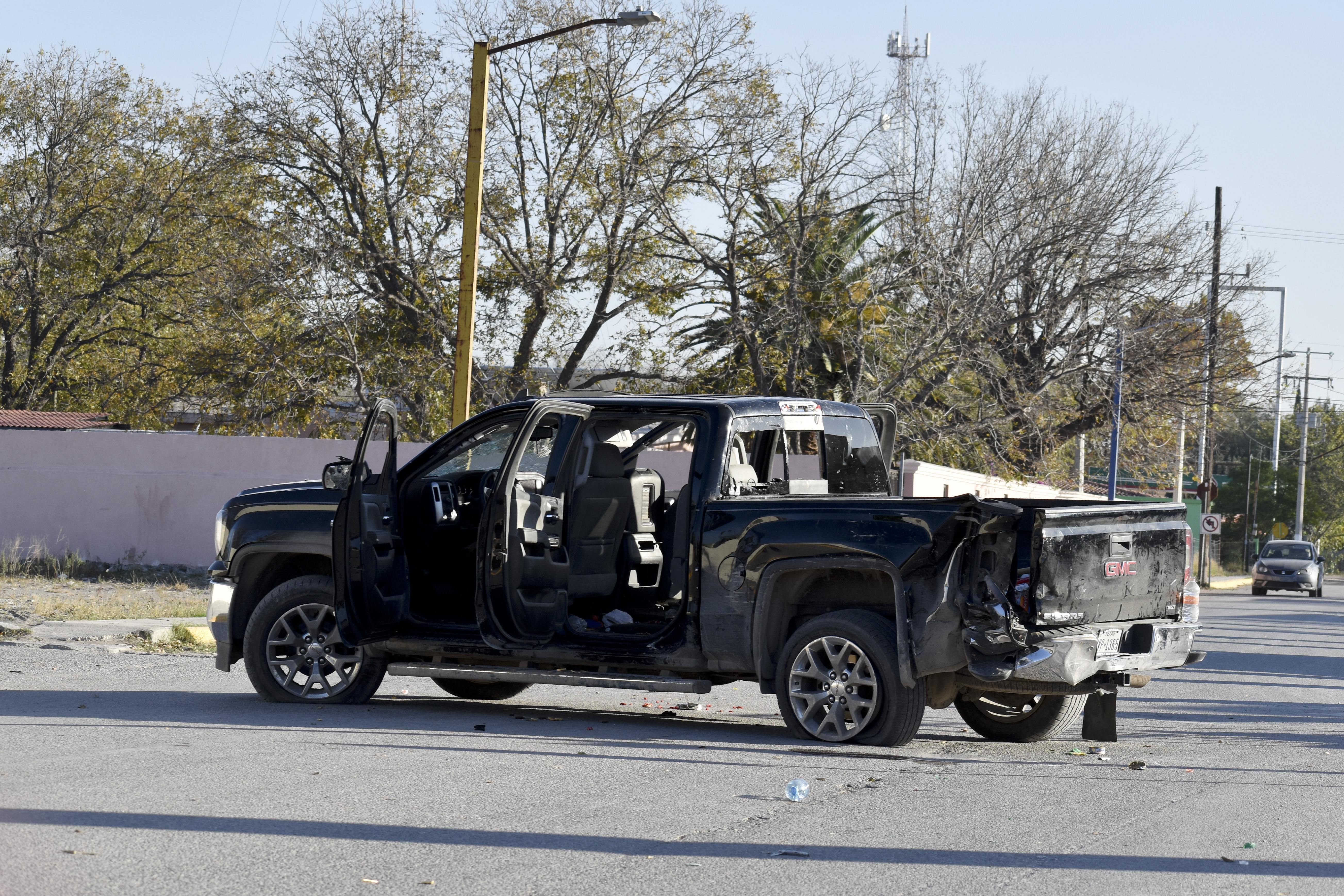 A damaged pick up is on the streets after a gun battle between Mexican security forces and suspected cartel gunmen, in Villa Union, Mexico, on Nov. 30, 2019.
