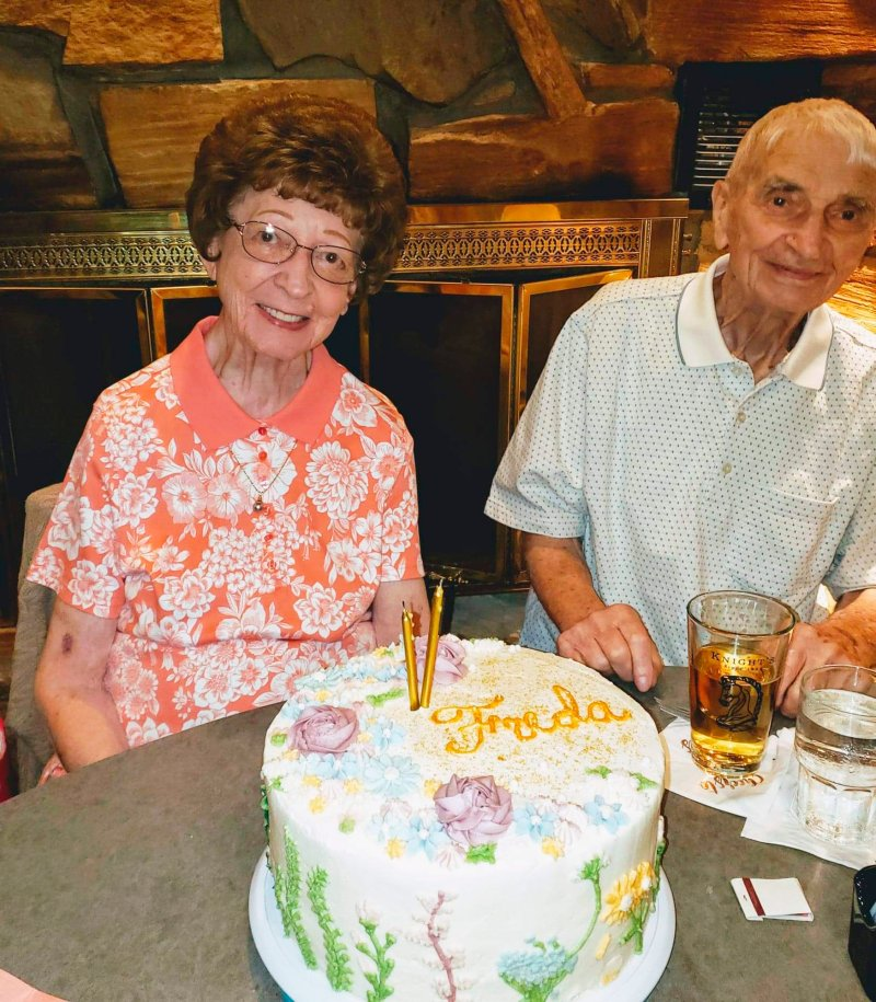 This photo provided by Leah Smith shows Les and Freda Austin of Jackson, Michigan posing for a photo at a birthday party in June 2019.