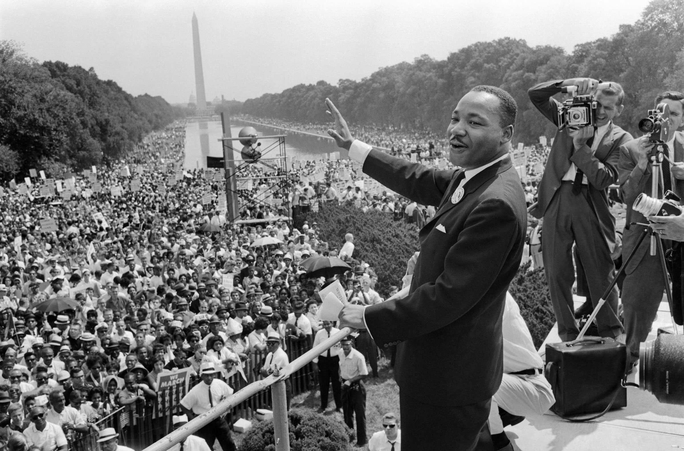 Dr. Martin Luther King, Jr. waves to supporters during the March on Washington on August 28, 1963.