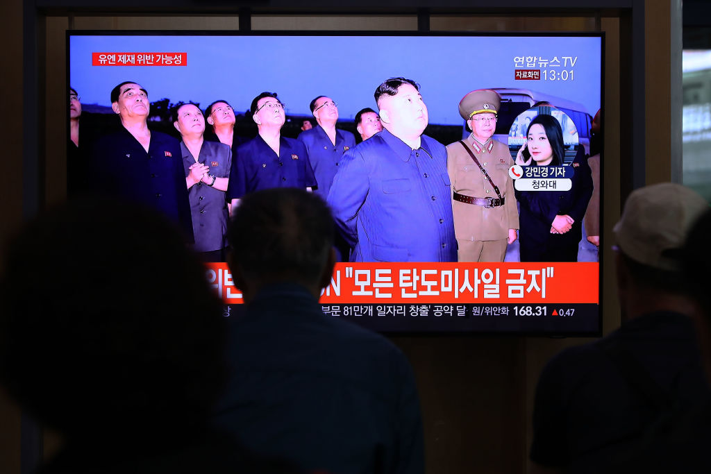People watch a TV showing a file image of a North Korean missile launch at the Seoul Railway Station in South Korea on Oct 2, 2019.